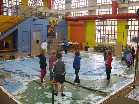 Kids in Pierre, South Dakota   enjoy National Geographic's Giant Traveling Map of the Pacific during the 2014 Water Festival. Photograph by Anne Lewis.