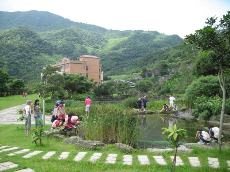 Taiwanese and American students work together in the  Science garden near the school. Photograph by Terry Smith