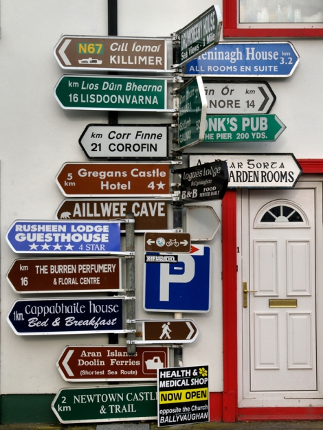 Signs in Ballyvaughan, County Clare, Ireland, point to many different places of interest. Photograph by Paolo Bernabei