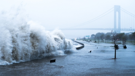 Hurricane Sandy devastated New York and New Jersey in October 2012. Here, a wave crashes into a walking path near the Verrazano-Narrows Bridge in Brooklyn. Photograph by Henry Zhang