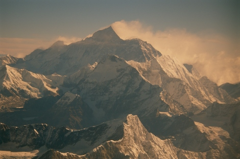 A cloud of snow blows from the summit of Mt. Everest. Photograph by Jodi Cobb.