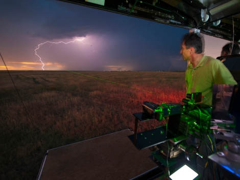 Tim Samaras, a veteran storm-chaser, took aim at a storm with a laser near Last Chance, Colorado, in 2009. Samaras, his son Paul, and a fellow storm-chaser Carl Young were killed while chasing a storm in El Reno, Oklahoma, on May 31. Photograph by Carsten Peter, National Geographic