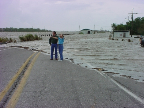 Sea-level rise is an impact of global warming. Rising temperatures cause ice to melt at the poles. As this polar ice melts, sea levels rise, causing floods in coastal areas. A storm surge on a Louisiana highway, above, shows the affects of sea level rise. Photograph courtesy NOAA