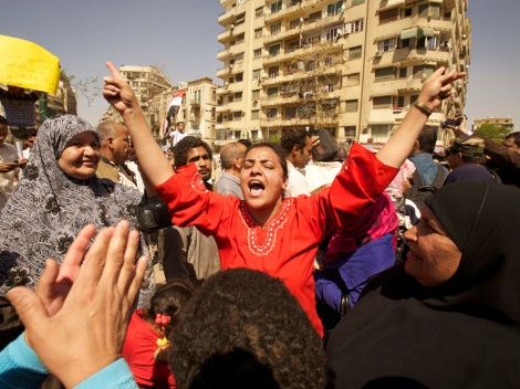 "Egyptian women dance a traditional ""dabke"" in Tahrir Square, Cairo, after the Egyptian Revolution of 2011, which overthrew the military regime of Hosni Mubarak and led to the democratic election of Mohamed Morsi. Morsi himself was forced out by the military less than two years later. Photograph by Alexandra Avakian, National Geographic"