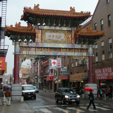 "Chain stores and high-rent condominiums are changing the character of Chinatowns in Boston, New York, and Philadelphia, according to a new report. If you can read Chinese, you'll know where this is—the large Chinese characters on the arch say ""Philadelphia Chinatown."" Photograph by Evrik, courtesy Wikimedia. This file is licensed under the Creative Commons Attribution 3.0 Unported license."