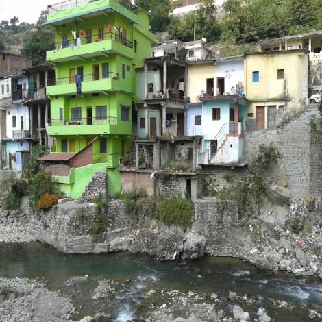 Photo by Dr. Prasanna Sriya; Illegal multi- storied construction by the river side
