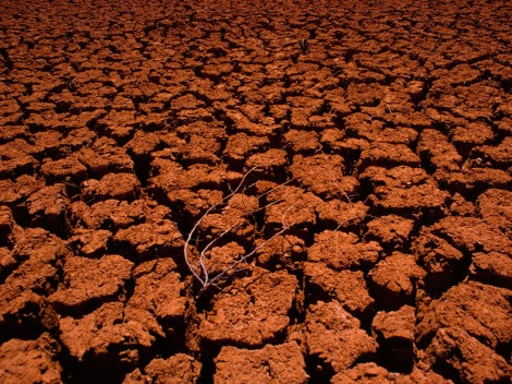 Cracked soil is a standard symbol of drought. Clay-based soils that are usually held together by moisture grow dry and brittle without it. Cracked soil is more vulnerable to erosion by wind, and so hard and dry that agriculture is nearly impossible. Photograph by James L. Stanfield, National Geographic