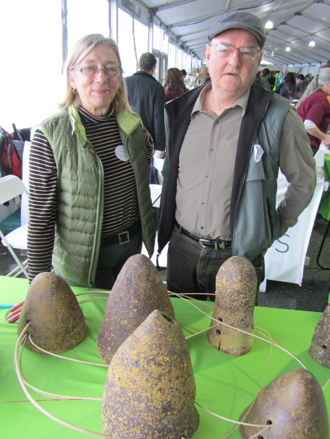 Mary O'Brien and Daniel McCormick show off their Watershed Sculptures. Photograph by Stuart Thornton, National Geographic