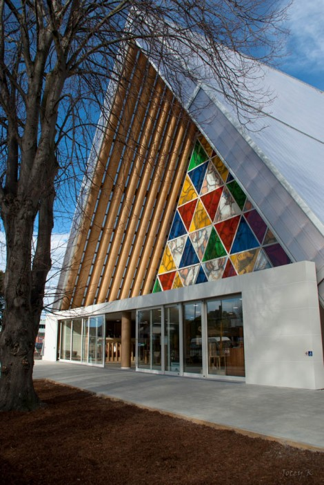 "One of Shigeru Ban's most well-known works is the ""Cardboard Cathedral"" in Christchurch, New Zealand. The city's 100-year old cathedral was severely damaged by an earthquake in 2011, and Ban's gorgeous temporary structure is a community and spiritual center serving the area while the permanent church is being completed. Photograph by Jocelyn Kinghorn, courtesy Wikimedia. This file is licensed under the Creative Commons Attribution-Share Alike 2.0 Generic license."