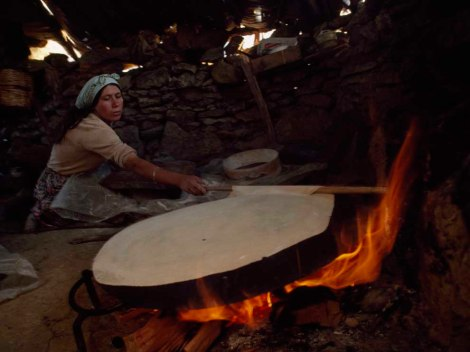Now, that's a tortilla. Actually, not even close. It's a Turkish bread called yufka. Innocuous indoor cooking stoves like this one are common throughout the developing world . . . and one of the leading causes of pollution-related deaths. Photograph by James L. Stanfield, National Geographic