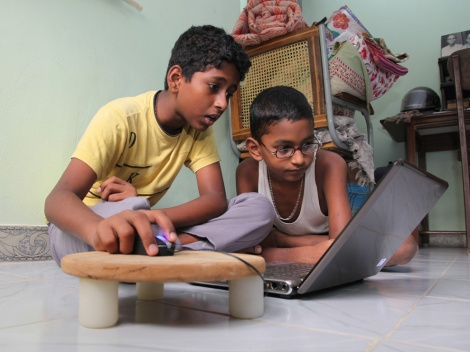 These boys in Chennai, India, seem to prefer their media on a screen, not a page. A new study of 2,000 British men found that 75% preferred a movie version of a story. Photograph by Mariajoseph Johnbasco, National Geographic Your Shot