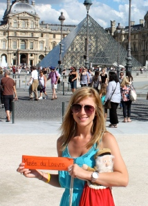 Breigh in front of the Louvre in Paris, France. Photo by Adam Rhodes.