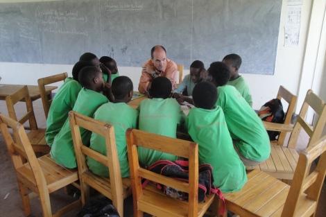 Kevin with students in Rwanda. Photo by John Gasangwa.