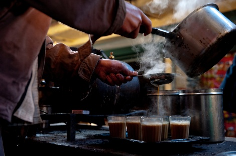 A vendor pours freshly made Chai in the village of Neelkanth, India. Photograph by Pete McBride/National Geographic Creative