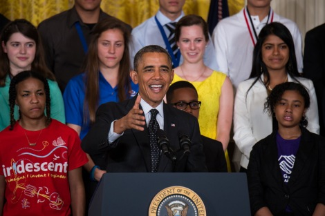 President Barack Obama and science fair exhibitors speak to the press at the 2014 White House Science Fair.  Photograph by NASA/Aubrey Gemignani. This file is licensed under the Creative Commons Attribution-Share Alike 2.0 Generic license.