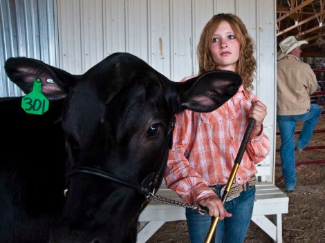 Both rural and urban school districts are incorporating hands-on agricultural classes to their traditional curricula. This high school student and her steer in Shelby, Montana, are actually part of 4H, not academia. Photograph by William Albert Allard, National Geographic