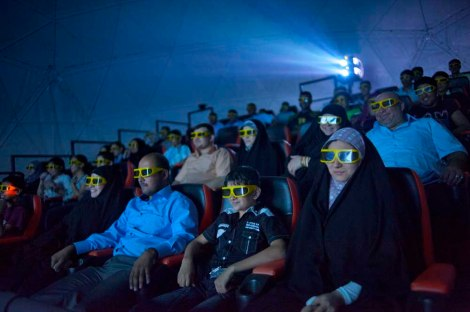 From silent classics to futuristic sci-fi thrillers, the way we represent our cities in film—these moviegoers are attending a 3D film in Baghdad, Iraq—says a lot about our urban future.  Photograph by Lynsey Addario, National Geographic