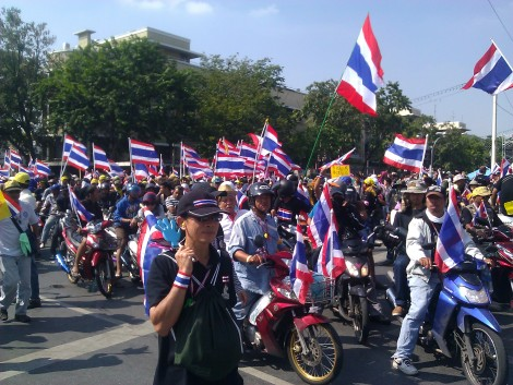 Thailand has been in a political crisis for more than six months. Democratically elected Prime Minister Yingluck Shinawatra dissolved the Thai House of Representatives in December 2013. In May, Shinawatra herself was removed from office by the Thai high court. Last week, General Prayuth Chan-ocha led a total military takeover of the state: The military leadership dissolved the Thai Senate and directed the judiciary to operate according to the military (effectively taking over the government); declared martial (military) law; banned political meetings and protests (like this one); arrested and detained authors, activists, and opposition politicians; censored the Internet; and took control of the media. Photograph by ilf, courtesy Wikimedia. This file is licensed under the Creative Commons Attribution-Share Alike 2.0 Generic license.