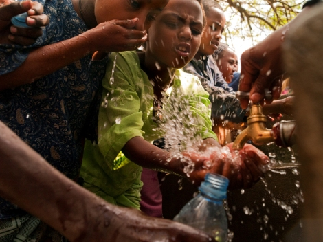 Students at a school in Kella, Ethiopia, crowd around a new tap during their afternoon water break. Photograph by Lynn Johnson, National Geographic