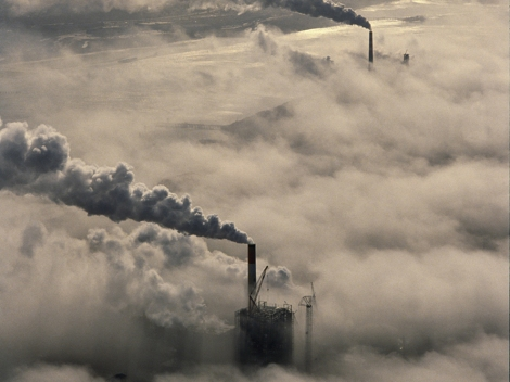 Smokestacks from pulp mills belch smoke above clouds near the coastal town of Eureka, California. Smokestacks, formally known as chimneys, emit smoke, steam, and other vapors into the atmosphere from an indoor fireplace, stove, boiler, or burner. Photograph by James P. Blair, National Geographic