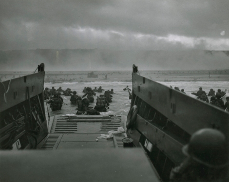 The Greatest Generation earns its nickname, storming Omaha Beach on D-Day. Photograph courtesy U.S. Coast Guard