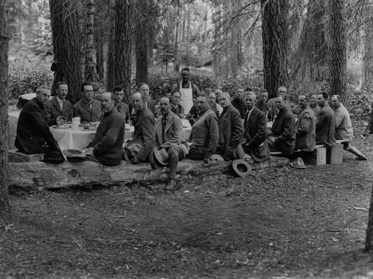 Doesn't everyone wear starched collars and three-piece suits to go camping? Photograph by Gilbert H. Grosvenor, National Geographic