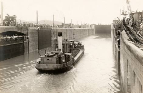 Crowds watch the first boat travel through the Miraflores Lock. Photo by Roscoe G. Searle