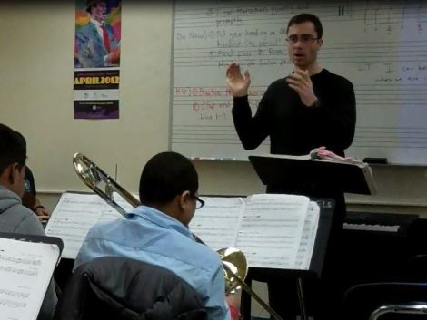 Graham teaching his band students in New York City.