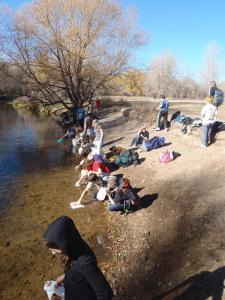 Students walked 3.5 miles to the Poudre River and carried as much water back as they could. Photograph by Kevin Denton