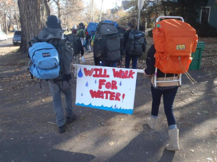 Students raised over $2,500 by walking with 100 gallons of water. Photograph by Kevin Denton