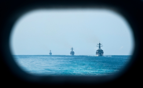 The guided missile destroyers USS Kidd (DDG 100), USS Pinckney (DDG 93) and USS Dewey (DDG 105) transit the South China Sea behind the aircraft carrier USS John C. Stennis (CVN 74) Feb. 2, 2012. John C. Stennis was operating in the U.S. 7th Fleet area of operations while on a seven-month deployment. (U.S. Navy photo by Mass Communication Specialist 3rd Class Kenneth Abbate/Released)