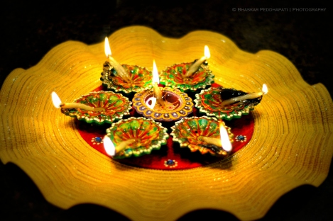"Do some lamp-lighting! According to Nat Geo Kids, ""The festival gets its name from the row (avali) of clay lamps (or deepa) that Indians light outside their homes to symbolize the inner light that protects us from spiritual darkness."" Photograph by peddhapati, courtesy Flickr. (CC BY 2.0)"