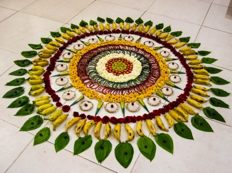 This delicious floral rangoli uses fresh fruit! Photograph by Thangaraj Kumaravel, courtesy Wikimedia. (CC-BY-2.0)