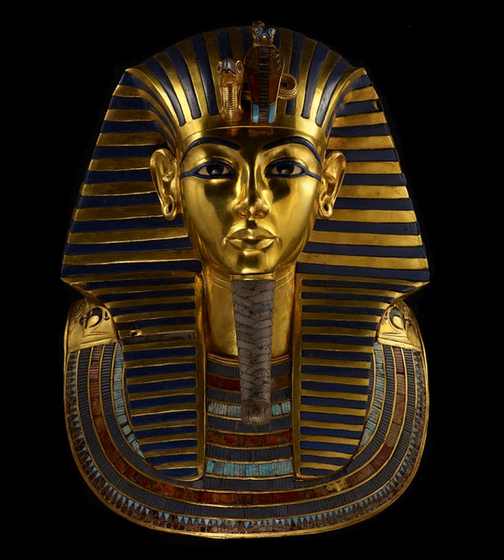 Tutankhamun's dazzling funeral mask was probably made for a female relative. The solid gold mask is inlaid with blue glass, painted ceramic, quartz, lapis lazuli, and obsidian. Photograph by Kenneth Garrett, National Geographic