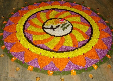 "Artists in Kerala create beautiful designs called ""pookalam"" using fragrant, fresh flower petals. Although pookalam are often associated with the Onam harvest festival, they are also created for Diwali. Photograph by Aruna, courtesy Wikimedia. (CC-BY-SA-3.0)"