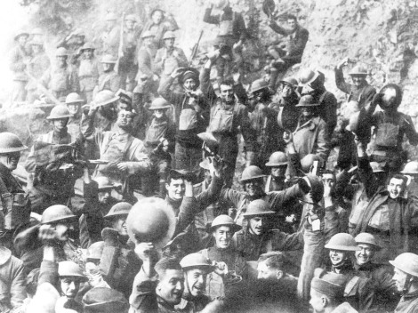 Soldiers of United States 64th Regiment, 7th Infantry Division, celebrate the news of the armistice that ended World War I on November 11, 1918. The 64th regiment, organized at Fort Baker, Texas, served in the Lorraine region of France. Photograph by the U.S. Army, courtesy the National Archive