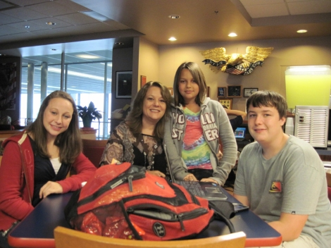 "Amanda, Lisa, Carolina, and Kyle Meuth relax at the USO Center at O'Hare International Airport during a six-hour layover from San Antonio, Texas, on their way to Munich, Germany. ""My husband is on mid-tour leave. We are meeting him in Munich and will travel to Paris and Rome. It's our first time visiting a USO Center,"" Lisa says. The USO (United Service Organizations) is a nonprofit organization whose mission is to lift the spirits of military service members and their families. Photograph by Mary Schons"