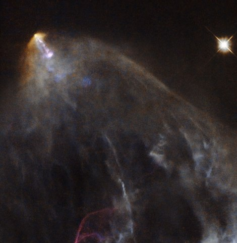Here is a view of HL Tau taken with the world-famous Hubble Space Telescope. (HL Tau is the bright spot in the upper left, streaming all that glowing material.) Photograph courtesy ESA/Hubble & NASA