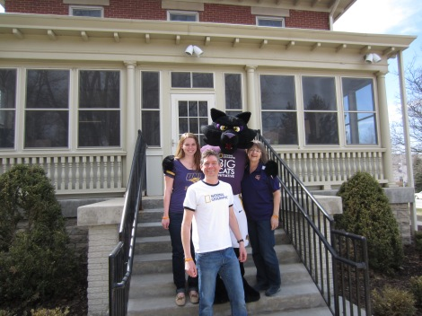 UNI's TC mascot poses with Mollie Ullestad (L) GAI Undergraduate Research Assistant, Alex Oberle (C) GAI Coordinator, and Ann Crawford (R) GAI Administrative Assistant