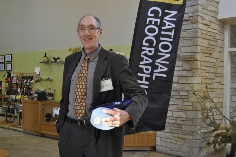 Ray Kinzie welcomes guests and hands out raffle tickets. Photograph by Lynn Szopinski