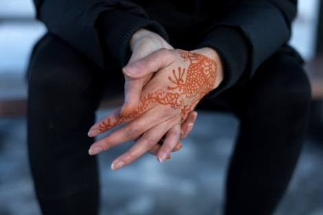 With henna on Saima feels connected to both her Pakistani background, and birth country of Qatar. Photograph by Colin Boyd Shafer