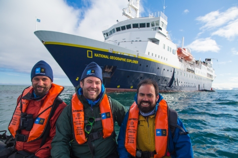 Adam Smith, Enrique Larreta and Garry Norman, Grosvenor Teacher Fellows, in Svalbard, Norway on board the National Geographic Explorer