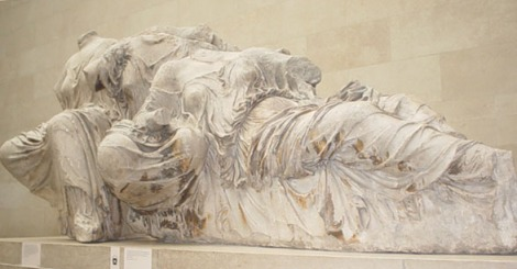"These ladies, in the famous Greek ""wet sheet"" drapery, filled out the other side of the tympanum. Photograph by Deepak, courtesy Wikimedia. (CC-BY-SA-2.0)"