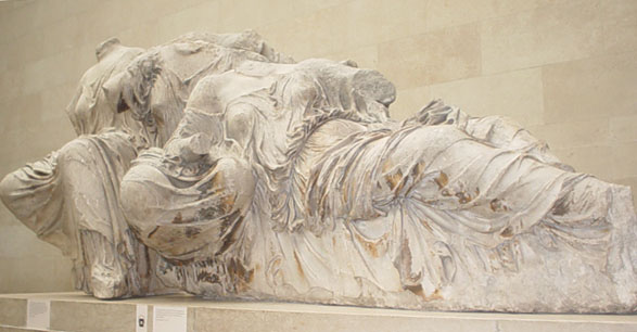 """These ladies, in the famous Greek """"wet sheet"""" drapery, filled out the other side of the tympanum. Photograph by Deepak, courtesy Wikimedia. (CC-BY-SA-2.0)"""