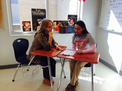 Angela Crawford and her student, Linh Phan, meet to discuss how her memorial design achieves her purpose. Photograph by