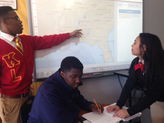 Tobias McCovery, Kendarius Burgess, and Linh Phan, AP students at Ben C. Rain High School in Mobile, Alabama, collaborate to map sites of proposed Civil Rights monuments using National Geographic's Mapmaker Interactive. Photograph by Angela Crawford