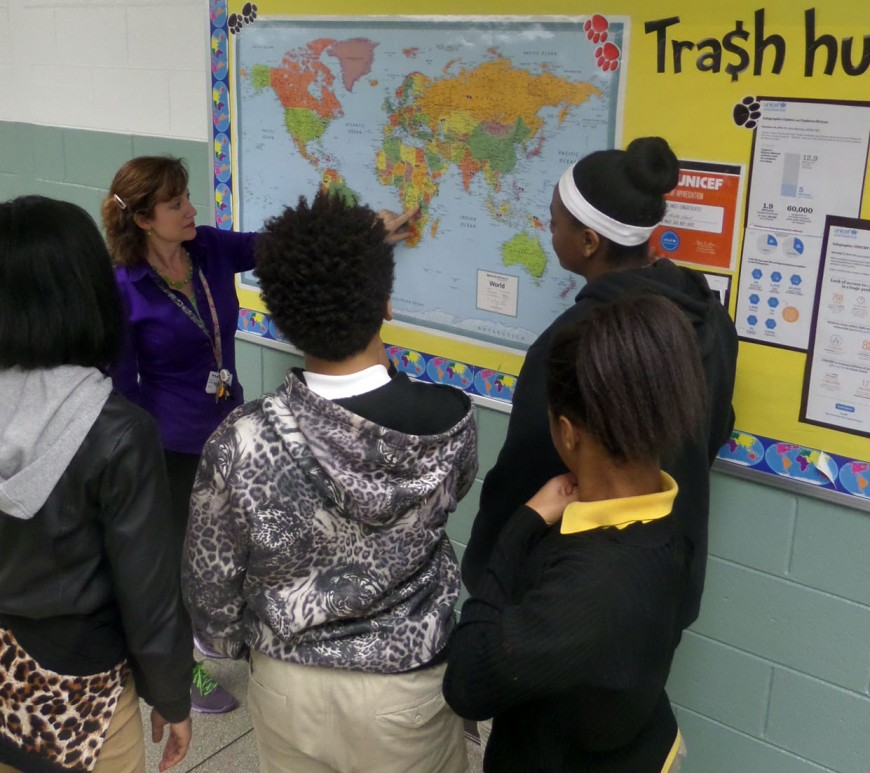 Photo of students looking at a map