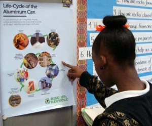 Photo of a student looking at a poster