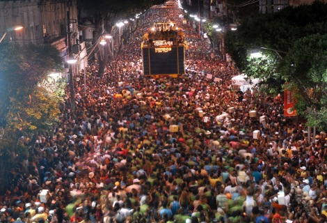 Millions of tourists flock to Brazil every year during Carnival. Here, thousands crowd the Bloco da Camisinha, in the city of Bahia. Photograph by Jurema Oliveira, courtesy Wikimedia. CC-BY-SA-3.0