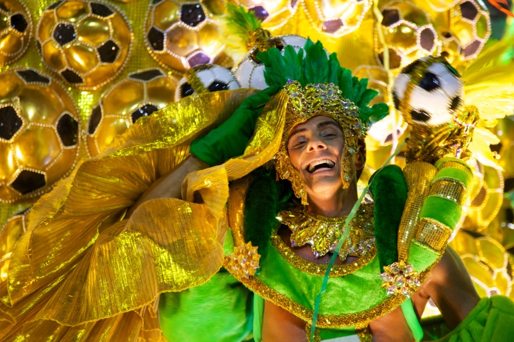 Where else could this be? A beautiful Sambista bedecked in Brazil's traditional green and yellow celebrates two of Brazil's great passions—soccer (futbol) and Carnival. Photograph by Nicolas de Camaret, courtesy Wikimedia. CC-BY-2.0